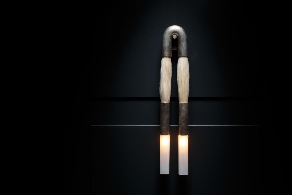 APPARATUS – HORSEHAIR SCONCE ON BLACK PANEL A low res